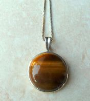 Sterling Silver Tigers Eye Stone Pendant And Silver Chain.